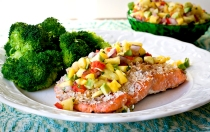 Whole30 compliant coconut salmon topped with the bright flavors of lime, mango, and pineapple.