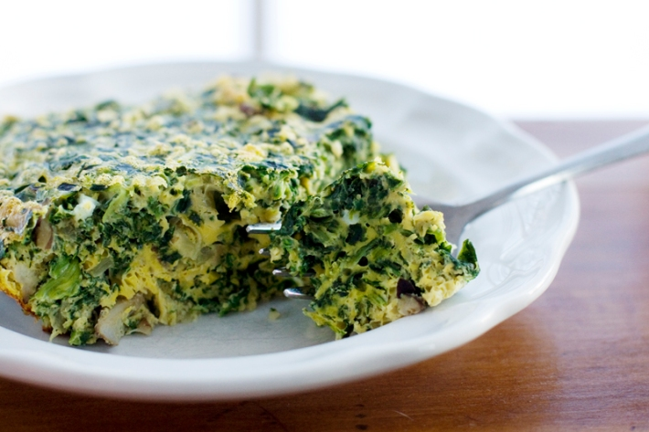 Spinach Mushroom Breakfast Casserole with fork